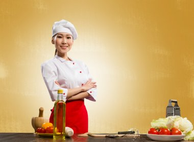 Asian cook woman crossed her arms