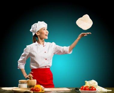 Chef throws piece pizza dough