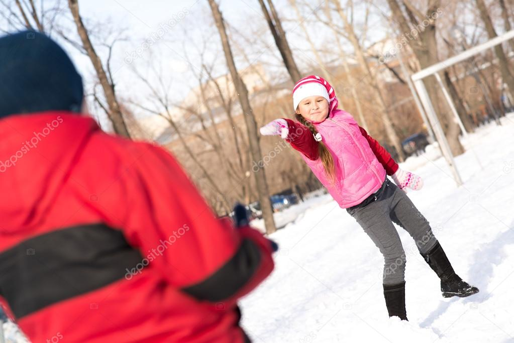 Children in Winter Park playing snowballs