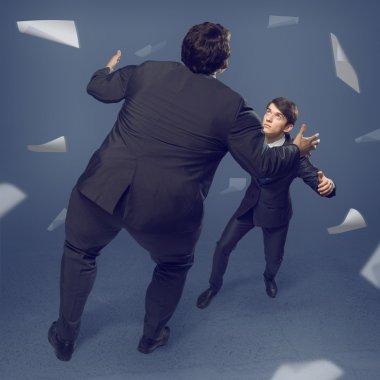 Two businessmen fighting as sumoist