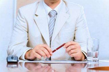 businessman holding a pen in hand