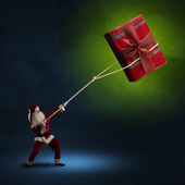 Ježíšek vytáhne krabičku s dárkem