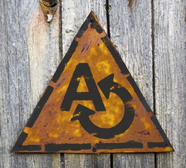 Translating Concept on Weathered Warning Sign.