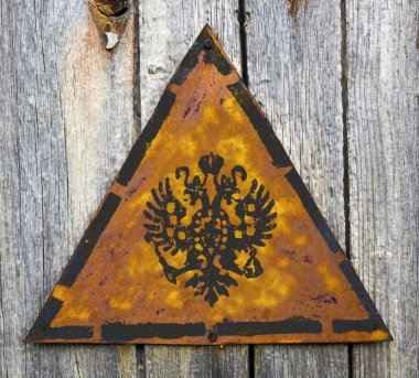 Russian Double Eagle on Rusty Warning Sign.