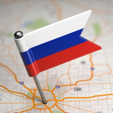 Russia Small Flag on a Map Background.