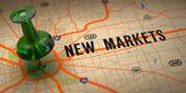 nové trhy - zelená připínáček na mapovém podkladu.