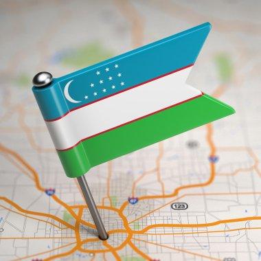 Uzbekistan Small Flag on a Map Background.