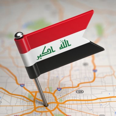 Iraq Small Flag on a Map Background.