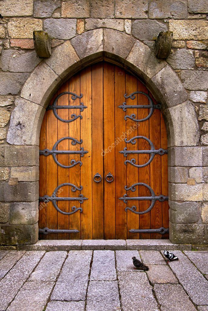 Beautiful old wooden door with iron ornaments in a medieval castle \u2014 Photo by ccaetano & Castle Door \u2014 Stock Photo © ccaetano #30944963
