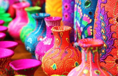 Colorful artistic pots or flower vases in vibrant colors