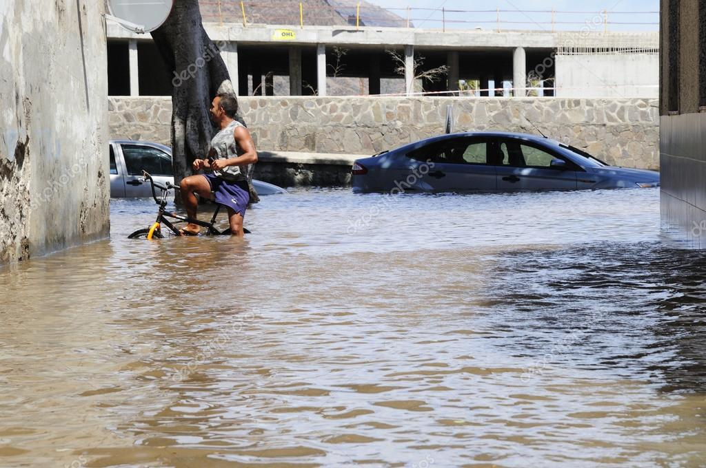 TENERIFE, SPAIN - AUGUST 29: Flooding due to high tide that floo