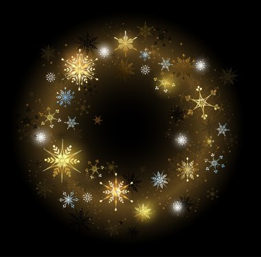 golden snowflakes on a black background