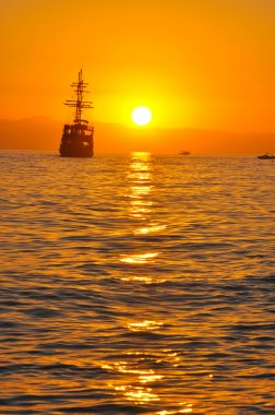 Pirate ship in sunset