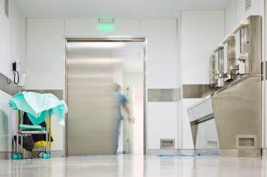 Blurred figure exiting hospital door