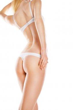 Rear view of beautiful woman in white bikini