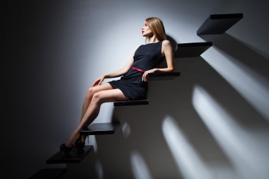 Model woman on ladder
