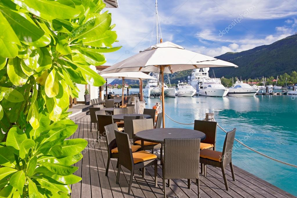 Cozy restaurant on decking by the beautiful marina at Eden Islan