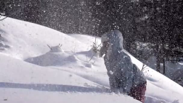 After Snowfall. Girl throws fluffy snow