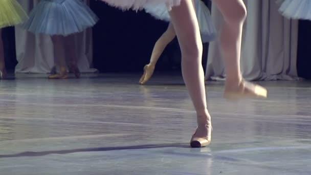 Ballerina on stage glow of spotlights