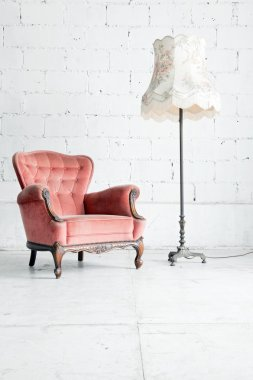 sofa with desk lamp in vintage room