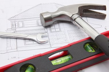 construction tools with house blueprint