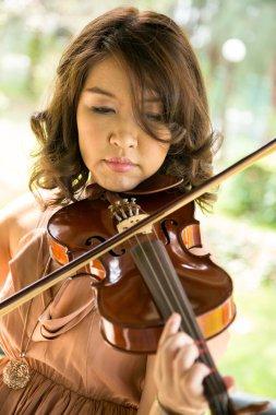 Young woman playing violin