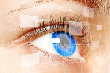 Woman blue eye looking on digital virtual screen