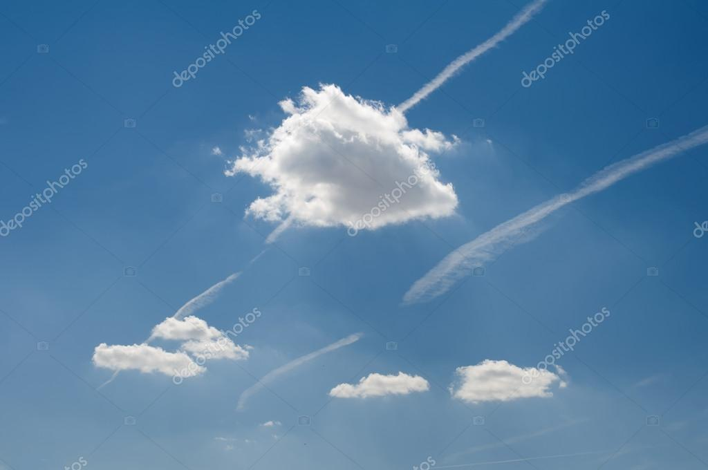 Traces of planes and clouds in the sky
