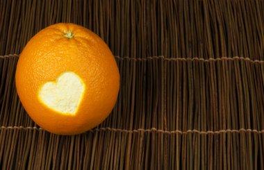 Heart shape carved in orange peel