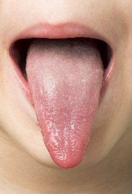 Human tongue protruding out