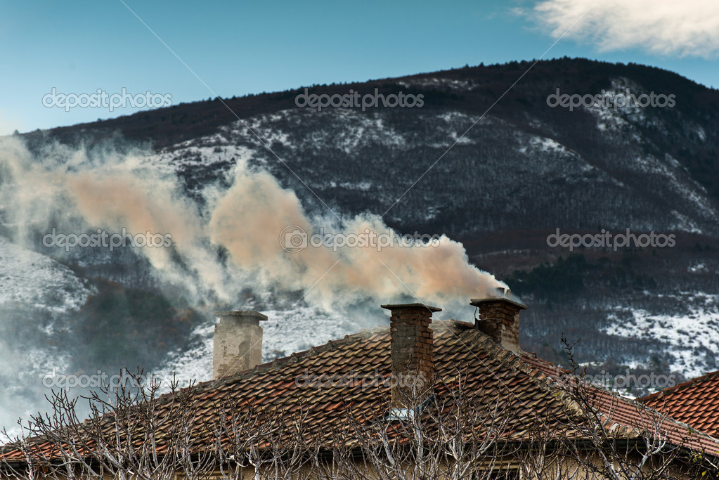 Chimney of the house and smoke