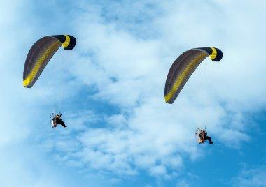 Paragliding fly on blue sky