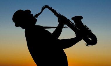 Saxophonist at sunrise