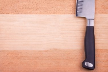 Sharp knife on cutting board