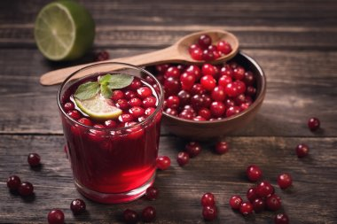 Cranberry juice on old wooden table