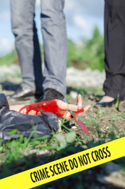 Close up view of bloody hand with knife