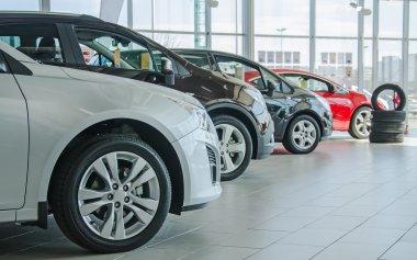 Several new cars at dealership salon. stock vector