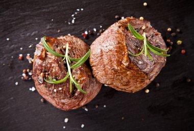 Fresh beef steaks on black stone