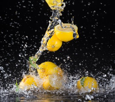 Fruit in water splashes