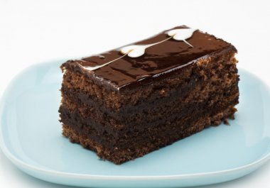 A piece of chocolate cake on a blue plate