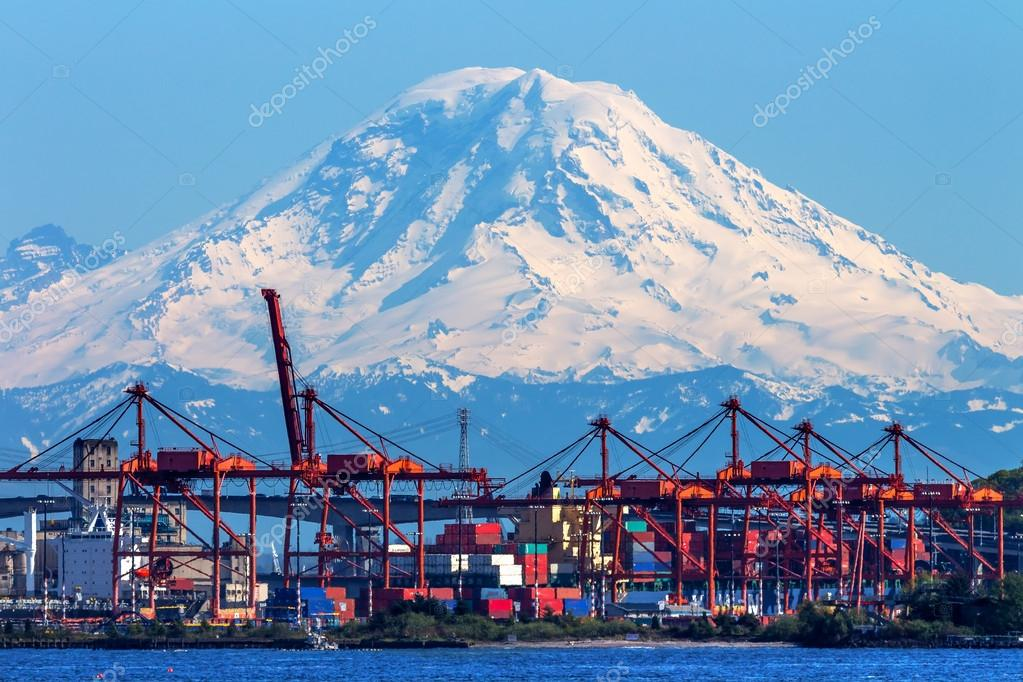 Seattle Port with Red Cranes and Boats with Mt Rainier in the ba
