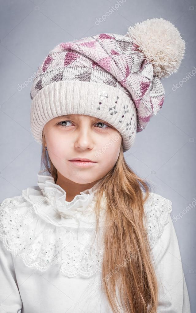 9320fc900 Portrait of an adorable baby girl wearing a knit pink and white ...