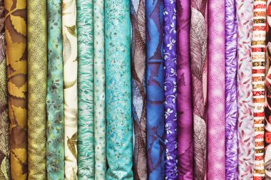 Rolls of colorful fabric as a vibrant background image stock vector