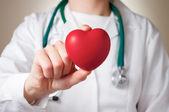Heart in doctors hand