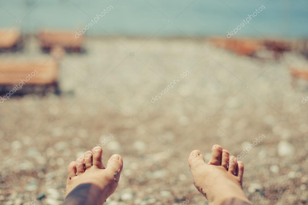 Womans legs on the beach