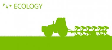 Agriculture tractors plowing the land in cultivated country fiel