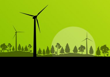 Wind electricity generators and windmills in countryside forest
