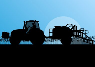 Agriculture tractor spraying pesticides in cultivated country gr