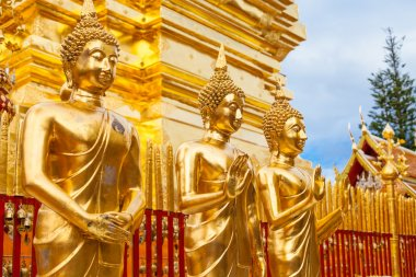 Gold statues of Buddha in a temple Doi Suthep