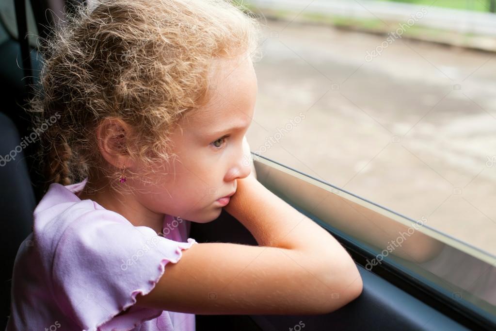 Sad Little Girl Sitting In The Car Near The Window  Stock -6284